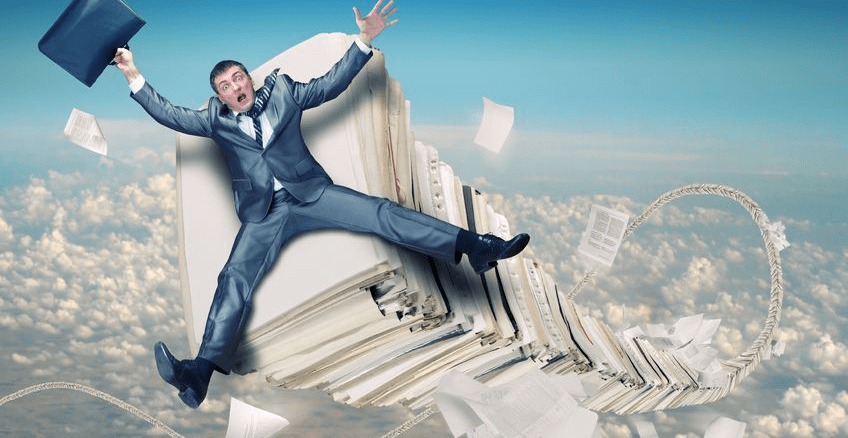Business Man Flying on a stack of paper