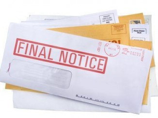 Stack of Mail with Final Notice on Top