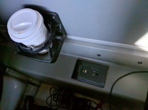 Cup holder and power outlets.